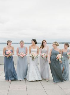 elegant mix and match bridesmaids dresses in long blue grey gowns | shades of grey Read More on SMP: http://www.stylemepretty.com/2016/02/26/charming-church-wedding-in-madison-wi/