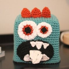 Your kids will want to grab a tissue instead of using their sleeve when you spruce up your Kleenex box with this Crochet Monster Box Cover!
