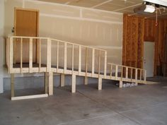 Wooden Handicap ramp inside garage.  >>> See it. Believe it. Do it. Watch thousands of spinal cord injury videos at SPINALpedia.com
