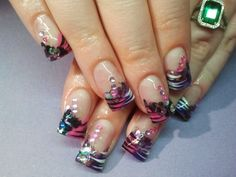 glitter acrylic nails.   Love them zebras    call Kristal at 916-670-0010 for an appointment in Sacramento
