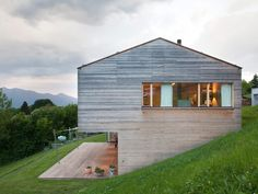 Zwischenwasser, a small Austrian village home to fewer than four thousand people, may be the last place you'd expect to find such vogue design. Nevertheless, a sleek modern home sits against a sloped hill in the quiet, secluded city. As you turn off the peaceful neighborhood street to cross a concrete bridge, this artful structure …
