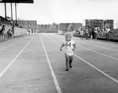 Black and white photo of 2½-year-old Kenny Andrieu running a lap at Hayward Field during an Oregon Track Club's all-comers meet in 1973. Picture appears on page four of the autumn 1973 issue of Old Oregon. ©University of Oregon Libraries - Special Collections and University Archives