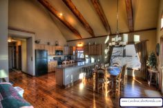 Deerwood Retreat Open, Relaxed Floor Plan With Exposed Beams and Elegant Decor Mountain Style, Exposed Beams, Window Wall, Table Games, Floor Plans, Windows, Flooring, Vacation, Living Room