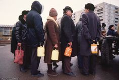 Signs of desperation: People stand in line with cans for food supplies in Tula, Russia, in November 1991