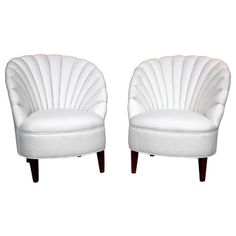"""A pair of newly-upholstered, shell-form armchairs. CIRCA DATA: Mid 20th Century DIMENSIONS: 32"""" h x 27"""" w x 25"""" d"""