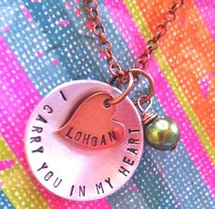 I ordered this in all silver with a pearl today. http://www.etsy.com/listing/93784321/i-carry-you-in-my-heart-3handstamped