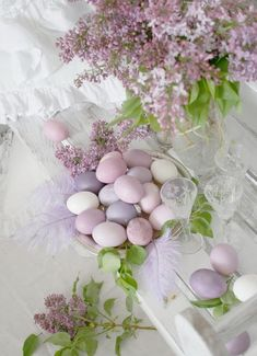Elegant easter tables cape using colored eggs and lilacs.