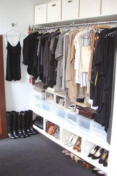 This is an inspiring closet. Off-season clothing is out of sight, everything has space and a place.