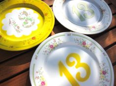 "MAKE | How-To: Table Number Plates [g> use gold ""chargers"" at end of each table..]"
