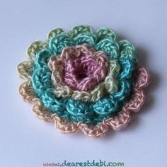 A simple layered flower pattern made with red heart unforgettable. http://dearestdebi.com/crochet-simple-layered-flower