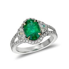 Brides.com: Green Engagement Rings Style 33203, heirloom emerald and half-moon diamond ring in 18K white gold, $8,000, Blue Nile  See more oval-cut engagement rings.Photo: Courtesy of Blue Nile