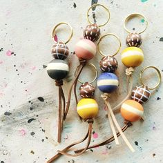 NEW!  These adorable key chains are made from beautiful, hand painted wooden…