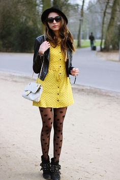 Yellow dress toughened up with black leather and boots
