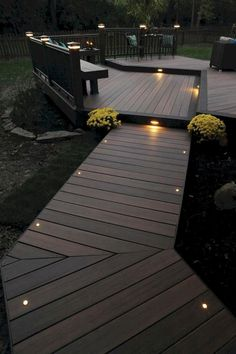 Home Remodel Exterior This more modern outdoor lighting makes a wood finish patio in a shabby chic garden look elegant.Home Remodel Exterior This more modern outdoor lighting makes a wood finish patio in a shabby chic garden look elegant. Outside House Decor, Timbertech Decking, Trex Decking, Patio Deck Designs, Deck Patio, Back Yard Design, Decking Area, Porch Designs, Patio Table