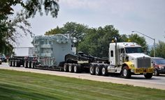 KW TriAxle and a 3x3x3 setup on a RGN trailer......