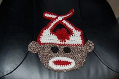 Ravelry: Sock Monkey Baby Bib pattern by Sara Sach Baby Bibs Patterns, Crochet Patterns, Crochet Ideas, Sock Monkey Baby, Crochet Baby Bibs, Bib Pattern, Christmas Sweaters, Christmas Ornaments, Crochet Kitchen