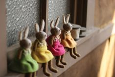 Spring fashion! Dress up your space with this set of four felt rabbits. So cute and colorful, these ladies are beautifully dressed for the occasion. What a perfect touch for a window perch or mantel. Needle Felted Animals, Felt Animals, Fabric Animals, Easter Crafts For Adults, Easter Ideas, Felt Bunny, Easter Bunny, Wooden Christmas Trees, Felt Christmas