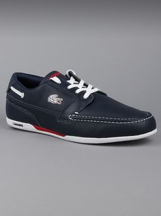 Lacoste Mens Leather Slip On Shoes Drefus in Blue  White With the Lacoste Dreyfus, the ever-popular deck shoe gets a dynamic reinterpretation. Sporty, casual, and exceedingly comfortable. Lacoste leather shoes are designed with butter soft leather and a sturdy rubber sole.