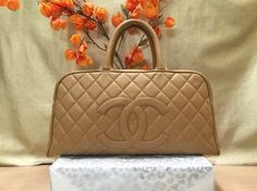 Chanel Quilted Caviar Leather Cc Large Bowling Doctor Boston Tan Tote Bag. Get one of the hottest styles of the season! The Chanel Quilted Caviar Leather Cc Large Bowling Doctor Boston Tan Tote Bag is a top 10 member favorite on Tradesy. Save on yours before they're sold out!