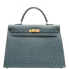 Preowned Hermes 35cm Blue Jean Ostrich Kelly Bag ($26,000) ❤ liked on Polyvore featuring bags, handbags, blue, kiss-lock handbags, hardware bag, zipper purse, ostrich handbag and zip lock bags