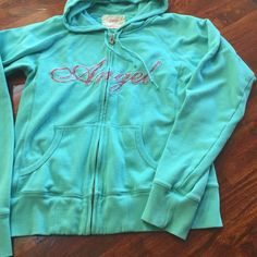Victoria Secret Angel hoodie Victoria Secrets Angel hoodie used but in great shape no stains or flaws light green with pink floral Angel writing Victoria's Secret Tops Sweatshirts & Hoodies