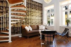 eclectic interior - This would be awesome if you had a huge book shelf instead of book wallpaper.
