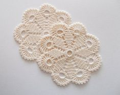 This is the listing for 6 crochet white cotton coasters or little doilies. They have been crochet with a steel hook of 2 mm using a 100% mercerized white cotton thread brand Durable nr. 10. You will get one larger and 5 small coasters. The 5 smaller ones are 9 cm or about 3.5 inches and the larger