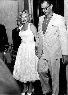 Marilyn Monroe - August 10, 1957 - leaving the New York City Hospital with husband Arthur Miller after suffering an ectopic pregnancy