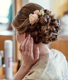 Cute updo wedding hairstyle with pink flower #bride