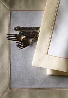 Hampshire: Tailored placemats, napkins and tablecloths are pure linen with contrasting linen appliquéd picture frame border and cording. Made to order in a choice of 21 colors. Allow 6 weeks.