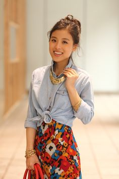 Love  uptying simple button up shirts and pairing  with printed skirts