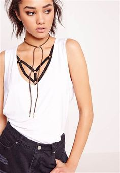 Add this affordable and simple rope choker necklace to your favorite outfit for a 90s inpired twist.