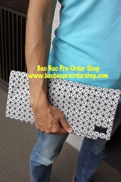 """C Clutch"" in White by Bao Bao Issey Miyake.  Design is ""unisex"". Fits both women & men. The clutch is very light in weight, soft & flexible. Multi-functional use.  >>To Order, please message/email via the platform below<< ♥️FB Inbox: https://www.facebook.com/messages/baobaohandbags ♥️Email: welovebaobao@gmail.com"