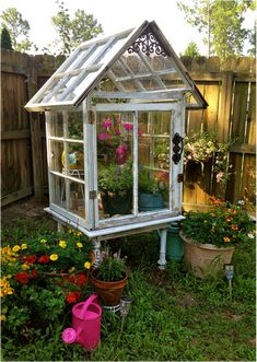 How to Build a Miniature Greenhouse from Old Windows Before you send your old windows straight to the landfill, consider recycling them into a project instead. Old windows can make a cute, inexpensive greenhouse that will brighten any yard or patio. Old Window Greenhouse, Small Greenhouse, Greenhouse Plans, Greenhouse Wedding, Greenhouse Gardening, Container Gardening, Backyard Projects, Cool Diy Projects, Garden Projects