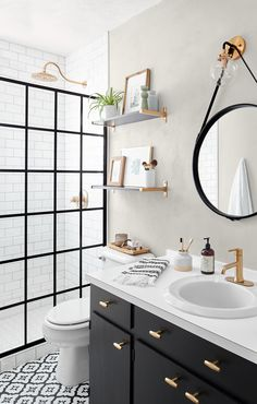 This Small Bath Makeover Blends Budget-Friendly DIYs and High-End Finishes This DIY bathroom remodel features a doorless shower, redone tile, and a gorgeous black and white theme. Black White Bathrooms, Modern White Bathroom, Black And White Bathroom Ideas, Bathroom Black, Classic Bathroom, White Rooms, Bad Inspiration, Home Decor Inspiration, Diy Bathroom Remodel