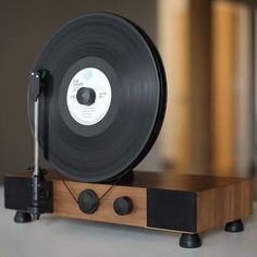 https://fancy.com/things/920685153796232856/Floating-Record-Vertical-Turntable?ref=ffemail