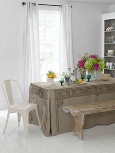 """This witty, stain-resistant slipcover turns a cafeteria-style folding table into a trompe l'oeil take on a fine Chippendale antique. (Cover, $68; 30""""W x 6'L; Under Stella's Umbrella for stores."""