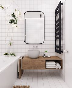 Bright Modern Scandinavian bathroom, interior in white with wooden details and green plants.