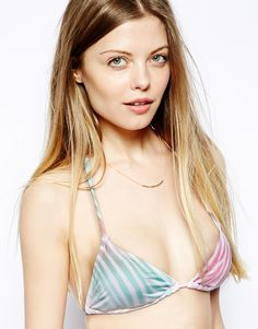 Triangle bikini top by Wildfox Made from a stretch swim fabric Soft sliding cups for adjustable coverage Multi-colour zebra print Halterneck style Self-tie string fastenings for an adjustable fit