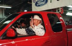 1998: Country music star Alan Jackson waves to plant personnel as he drives a Special Anniversary Edition Ford F-150 Series truck off the assembly line, Friday, March 6, 1998 in Norfolk, Va. Jackson, a spokesman for Ford Motor Company was at the plant to help celebrate the 50th anniversary of the Ford F-Series truck.