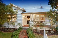 White on white Californian Bungalow. 10 A'Beckett Street  COBURG $570,000 - $620,000 @ domain.com.au