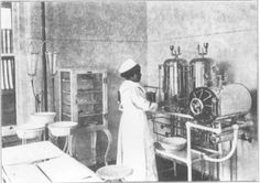 Riverside, CA, 1916. Nurse getting what looks like sterile water from urn.