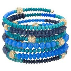 """A colorful anchor for bold ensembles and neutral outfits alike, this chic beaded coil bracelet offers bright style with a touch of sparkle.   Product: BraceletConstruction Material: Metal and resin beads Color: Cerulean, sapphire and midnight blueFeatures:  Wire coil wrapLead-free and nickel-freeDimensions: 2.5"""" Diameter"""