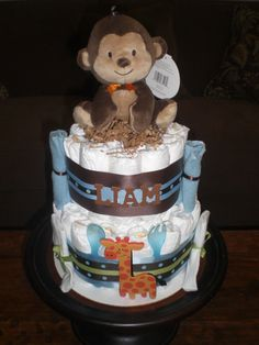 Items similar to Monkey Diaper Cake Jungle Theme Baby Shower Centerpiece or gift elephant available and other ribbon colors too on Etsy Baby Shower Diapers, Baby Shower Cakes, Baby Shower Themes, Shower Ideas, Safari Diaper Cakes, Monkey Diaper Cakes, Jungle Safari, Jungle Theme, Baby Shower Centerpieces