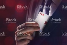 Magician pulling an ace of hearts out of his lapel royalty-free stock photo