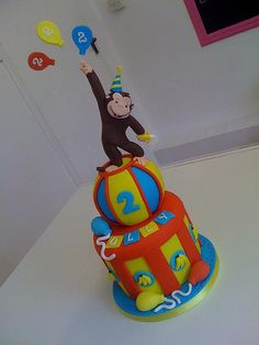 Curious George cake by trulycrumbtious, via Flickr