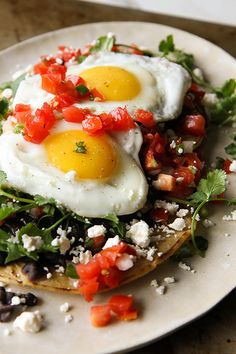 Huevos Rancheros by heathercristo #eggs #HuevosRancheros #breakfast #recipe #cilantro #CornTortilla #BlackBeans