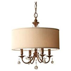 A brunt copper drum shade covers the beautiful traditional Clarissa chandelier in Firenze Gold. Four lights inside illuminate lovely glass bead accents. This would be a perfect dining room chandelier.