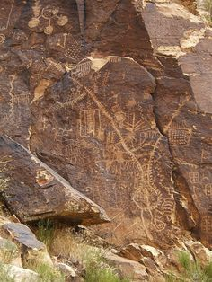 *UTAH ~ Parowan Gap is a passage through the Red Hills near Cedar City. It has a marvelous selection of petroglyphs, of which the most amazing is this solar calendar which marks the seasons as the sun passes through the gap. For more information on this calendar see www.parowangap.org/ These petroglyphs were carved approximately 1000 years ago by the ancestors of the Southern Paiute or by the people of the Sevier-Fremont culture.