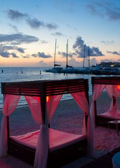 sexy beach evening..love the open cabanas for two...